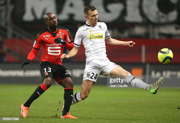 Giovanni Sio of Rennes and Romain Thomas of Angers in action during the French Ligue 1 match between Stade Rennais FC and SCO Angers at Roazhon Park...