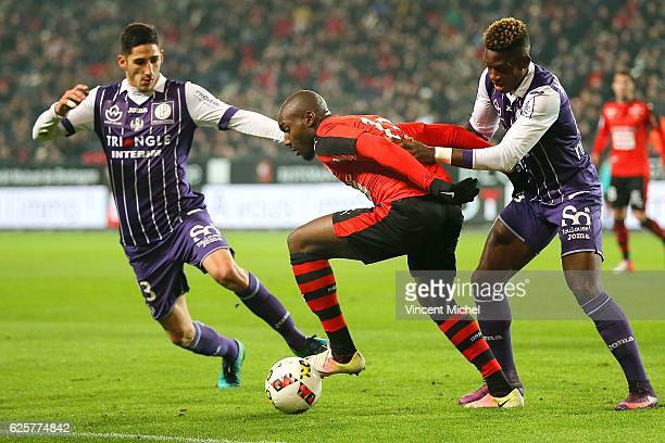 Giovanni Sio of Rennes and Yann Bodiger and Francois Moubandje of Toulouse during the French Ligue 1 match between Rennes and Toulouse at Roazhon...