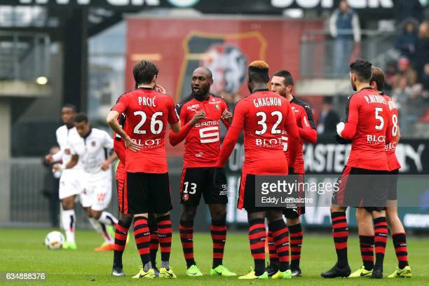 Giovanni Sio of Rennes speaks with his team mates after scoring a goal during the Ligue 1 match between Stade Rennais and OGC Nice at Roazhon Park on...