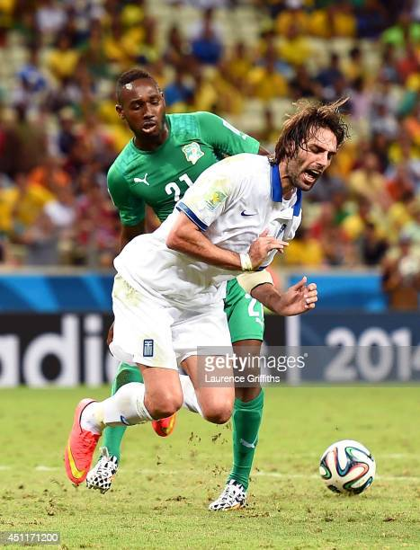 Giovanni Sio of the Ivory Coast fouls Giorgos Samaras of Greece resulting in a penalty kick during the 2014 FIFA World Cup Brazil Group C match...