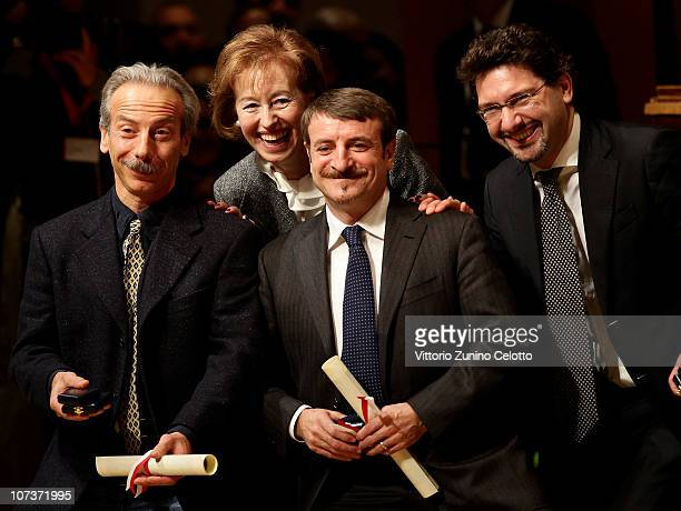 Giovanni Storti Letizia Moratti Giacomo Poretti Manfredi Palmeri attend the Ambrogino D'Oro 2010 held at Teatro Dal Verme on December 7 2010 in Milan...