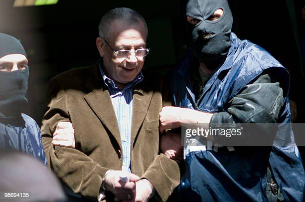 Giovanni Tegano a top mafia boss who was among the country's 30 most dangerous fugitives is escorted from police headquarters after his arrest in the...