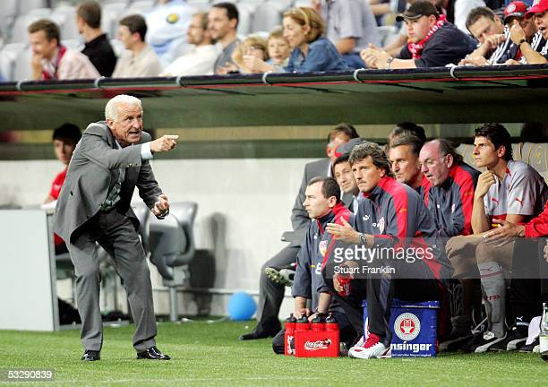 Giovanni Trapattoni, coach of Stuttgart, shouts instructions during the Premiere-Liga Pokal match between FC Bayern Munich and Vfb Stuttgart on July...
