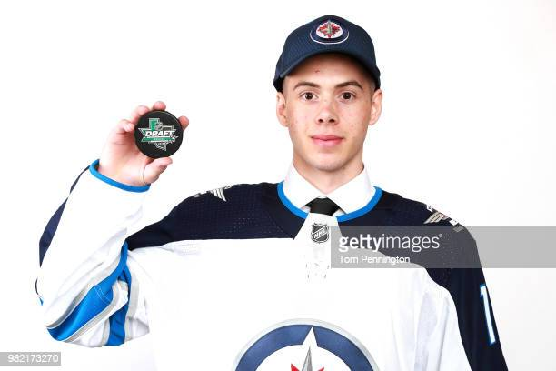 Giovanni Vallati poses after being selected 153rd overall by the Winnipeg Jets during the 2018 NHL Draft at American Airlines Center on June 23 2018...