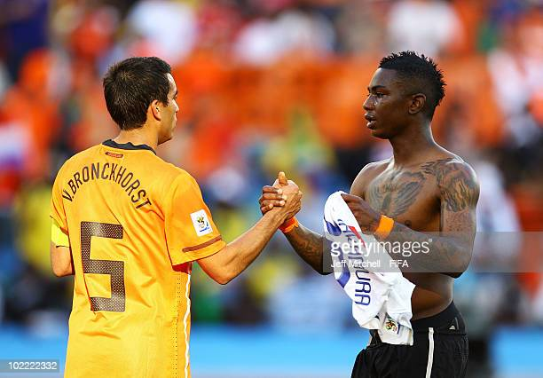 Giovanni Van Bronckhorst and Eljero Elia of the Netherlands celebrate victory at the end of the 2010 FIFA World Cup South Africa Group E match...