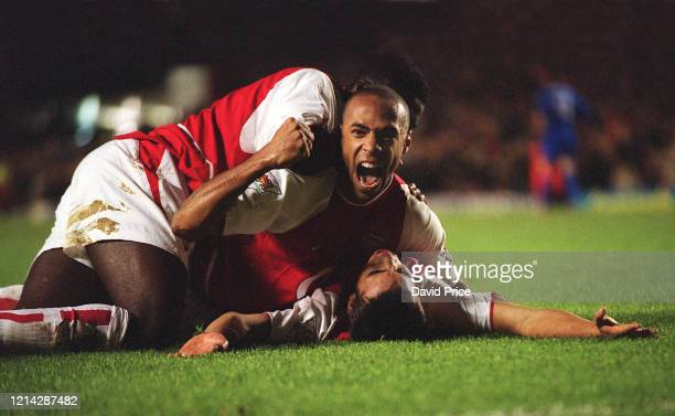 Giovanni van Bronckhorst celebrates scoring a goal for Arsenal with Thierry Henry and Kolo Toure during the Premier League match between Arsenal and...