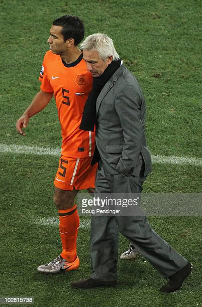 Giovanni Van Bronckhorst is consoled by Bert van Marwijk head coach of the Netherlands after losing the 2010 FIFA World Cup South Africa Final match...