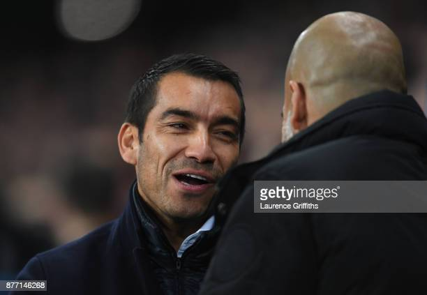 Giovanni Van Bronckhorst Manager of Feyenoord and Josep Guardiola Manager of Manchester City greet each other during the UEFA Champions League group...
