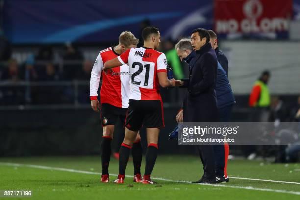 Giovanni Van Bronckhorst Manager of Feyenoord speaks to Sofyan Amrabat of Feyenoord during the UEFA Champions League group F match between Feyenoord...