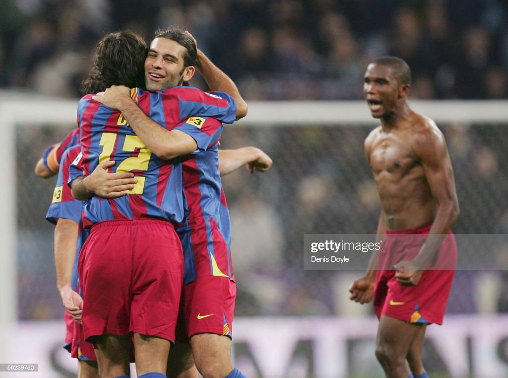 Giovanni van Bronckhorst (L) of Barcelona embraces Rafael Marquez while Samuel Eto'o celebrates after they beat Real Madrid 3-0 during a Primera Liga match between Real Madrid and F.C. Barcelona at the Bernabeu on November 19, 2005 in Madrid, Spain.