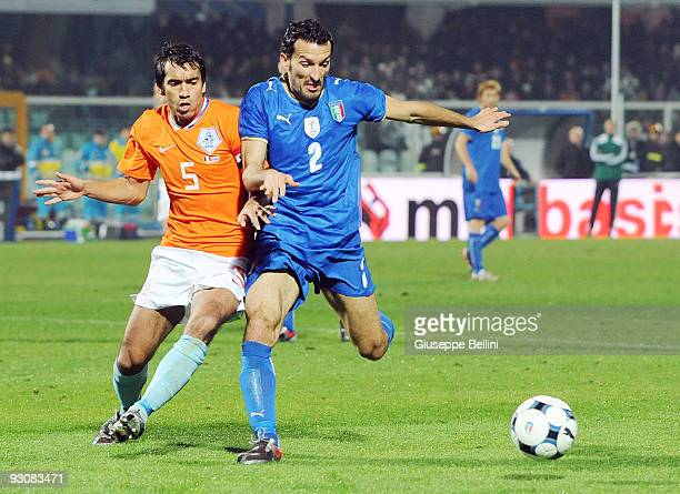 Giovanni van Bronckhorst of Holland and Gianluca Zambrotta of Italy in action during the International Friendly Match between Italy and Holland at...