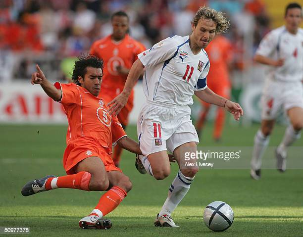 Giovanni Van Bronckhorst of Holland clashes with Pavel Nedved of the Czech Rep during the UEFA Euro 2004 Group D match between Holland and the Czech...