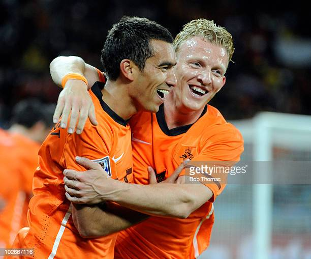 Giovanni van Bronckhorst of the Netherlands celebrates his goal with teammate Dirk Kuyt during the 2010 FIFA World Cup South Africa Semi Final match...