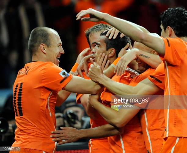 Giovanni van Bronckhorst of the Netherlands celebrates his goal with teammates including Arjen Robben during the 2010 FIFA World Cup South Africa...
