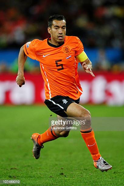 Giovanni Van Bronckhorst of the Netherlands in action during the 2010 FIFA World Cup South Africa Round of Sixteen match between Netherlands and...