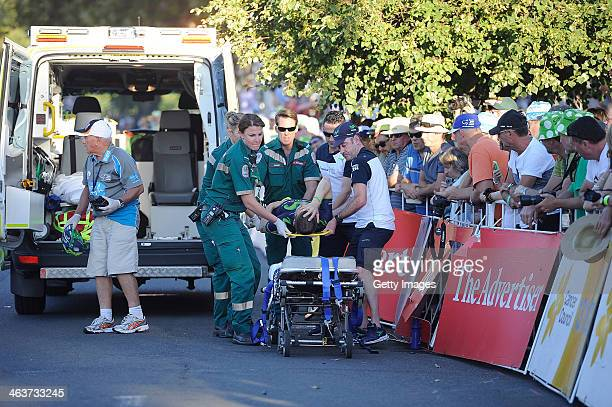 Giovanni Visconti from Moviestar is lifted into an Ambulance after crashing in the Peoples Choice Criterium during day one of the Tour Down Under on...