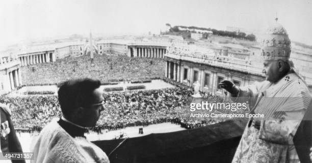 Giovanni XXIII blesses the huge crowd from the lateral balcony of the Vatican Basilica April 22 1962.