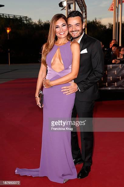Giovanni Zarella and Jana Ina Zarella attend the Deutscher Fernsehpreis 2013 - Red Carpet Arrivals at Coloneum on October 02, 2013 in Cologne,...