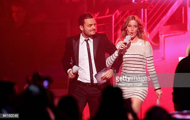 Giovanni Zarrella and Charlotte Engelhardt pose during the TV Show 'Popstars You & I' semi final at the Koenigspilsener Arena on December 8, 2009 in...