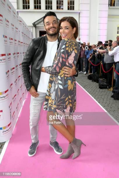 Giovanni Zarrella and his wife Jana Ina Zarrella during the Ernsting's family Fashion Show 2019 on July 11, 2019 in Hamburg, Germany.
