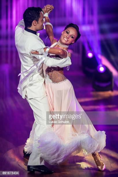Giovanni Zarella and Marta Arndt perform on stage during the semi final of the tenth season of the television competition 'Let's Dance' on June 2...
