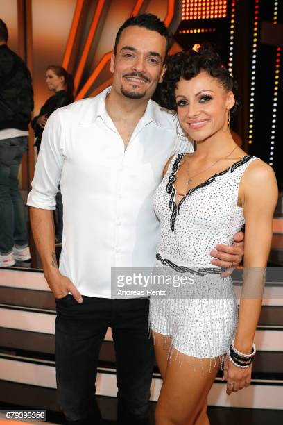 Giovanni Zarrella and Marta Arndt pose on stage during the 7th show of the tenth season of the television competition 'Let's Dance' on May 5 2017 in...
