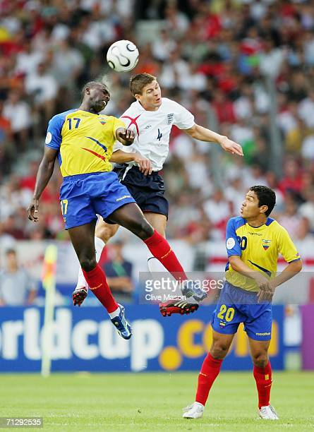Giovanny Espinoza of Ecuador jumps for a header with Steven Gerrard of England during the FIFA World Cup Germany 2006 Round of 16 match between...