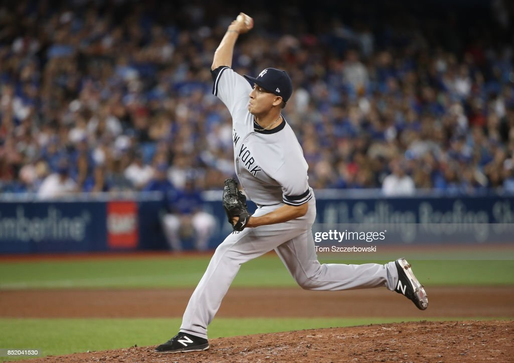 Giovanny Gallegos #50 of the New York Yankees delivers a pitch in the eighth inning during MLB game action against the Toronto Blue Jays at Rogers Centre on September 22, 2017 in Toronto, Canada.