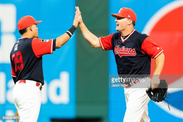 Giovanny Urshela celebrates with Jay Bruce of the Cleveland Indians after the Indians defeated the Kansas City Royals at Progressive Field on August...