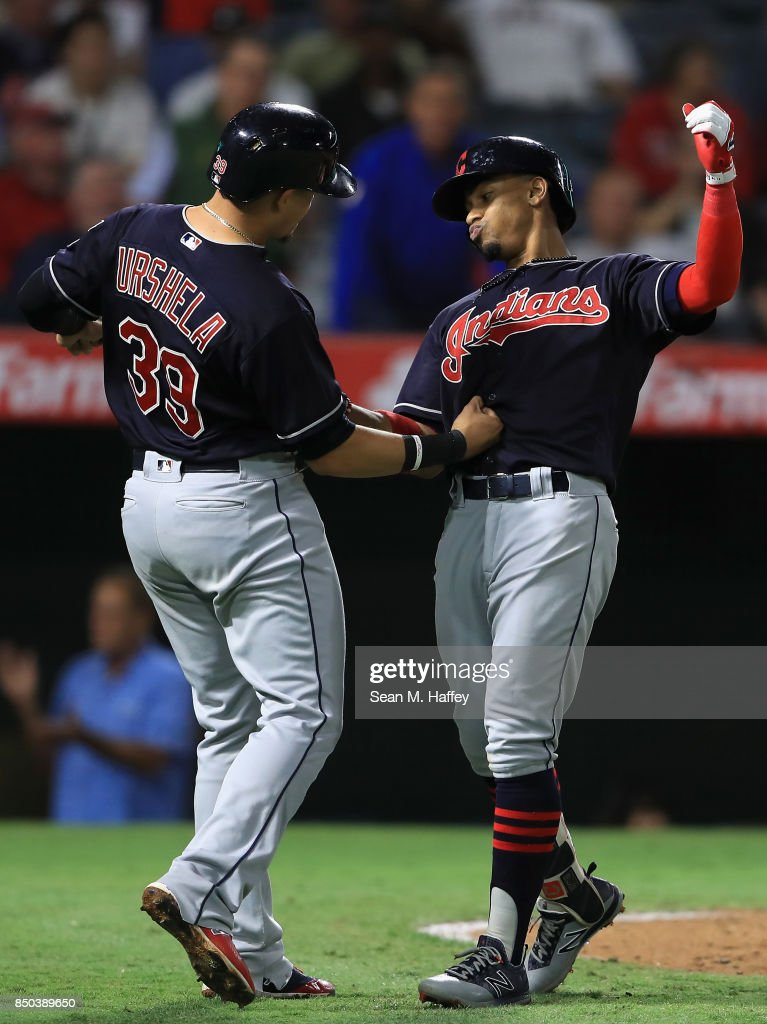 Giovanny Urshela #39 congratulates Francisco Lindor #12 of the Cleveland Indians after his two-run homerun during the seventh inning of a game against the Los Angeles Angels of Anaheim at Angel Stadium of Anaheim on September 20, 2017 in Anaheim, California.