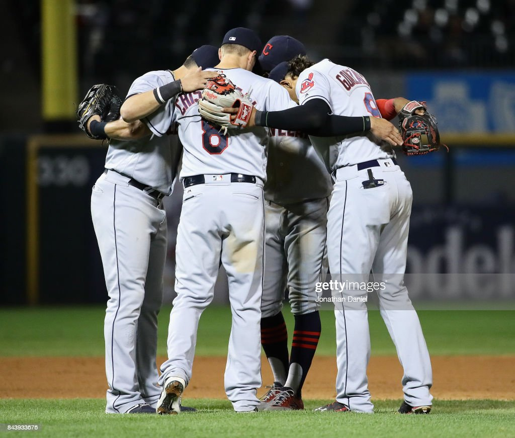 Giovanny Urshela #39, Lonnie Chisenhall #8, Francisco Lindor #12 and Erik Gonzalez #9 of the Cleveland Indians huddle after a win against the Chicago White Sox at Guaranteed Rate Field on September 7, 2017 in Chicago, Illinois. The Indians defeated the White Sox 11-2.