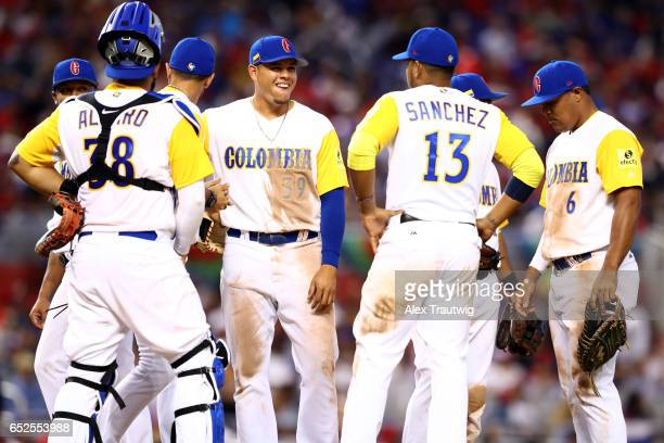 Giovanny Urshela of Team Colombia smiles during a pitching change during Game 5 of Pool C of the 2017 World Baseball Classic against Team Dominican...