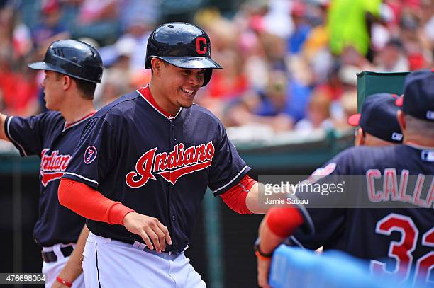 Giovanny Urshela of the Cleveland Indians celebrates after scoring a run in the third inning against the Seattle Mariners at Progressive Field on...