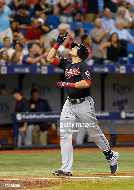 Giovanny Urshela of the Cleveland Indians celebrates as he nears home plate following his threerun home run during the seventh inning of a game...