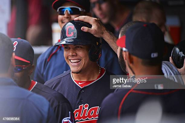 Giovanny Urshela of the Cleveland Indians celebrates in the dugout after hitting his first career major league home run in the fifth inning against...