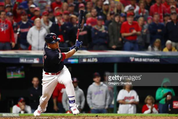 Giovanny Urshela of the Cleveland Indians hits a single scoring Jay Bruce in the fifth inning against the New York Yankees in Game Five of the...