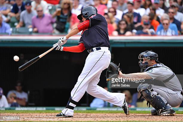 Giovanny Urshela of the Cleveland Indians hits his first career major league home run in the fifth inning against the Seattle Mariners at Progressive...