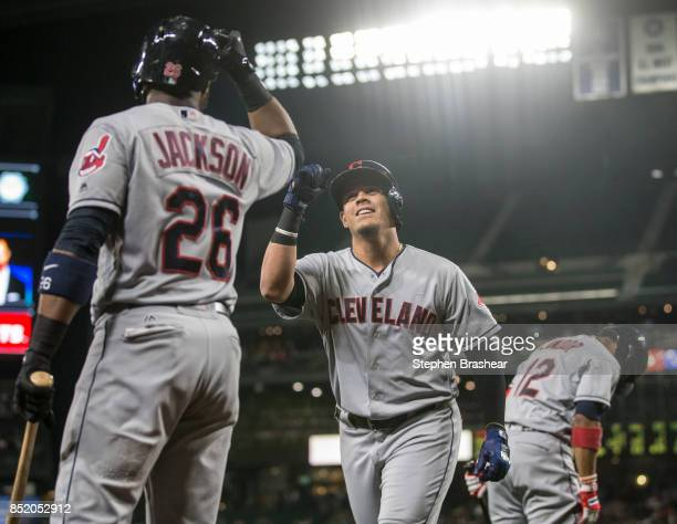 Giovanny Urshela of the Cleveland Indians is greeted by Austin Jackson of the Cleveland Indians after hitting a solo home run off of starting pitcher...