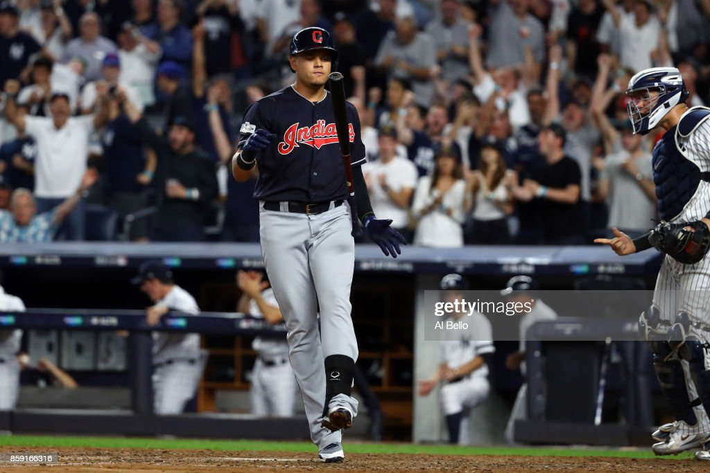 Giovanny Urshela #39 of the Cleveland Indians reacts after striking out during the eighth inning against the New York Yankees in game three of the American League Division Series at Yankee Stadium on October 8, 2017 in New York City.
