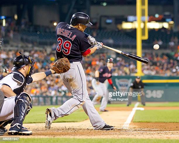 Giovanny Urshela of the Cleveland Indians singles in the fifth inning during a MLB game against the Detroit Tigers at Comerica Park on September 4...