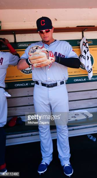 Giovanny Urshela of the Cleveland Indians stands in the dugout prior to the game against the Oakland Athletics at the Oakland Alameda Coliseum on...