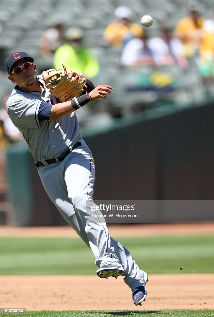 Giovanny Urshela #39 of the Cleveland Indians throws off balance to first base throwing out Matt Chapman #26 of the Oakland Athletics in the bottom of the third inning at Oakland Alameda Coliseum on July 16, 2017 in Oakland, California.