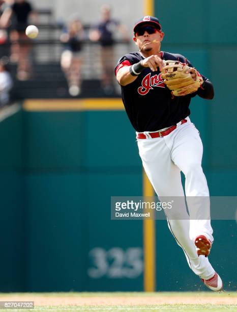 Giovanny Urshela of the Cleveland Indians throws out Clint Frazier of the New York Yankees in the ninth inning at Progressive Field on August 6 2017...