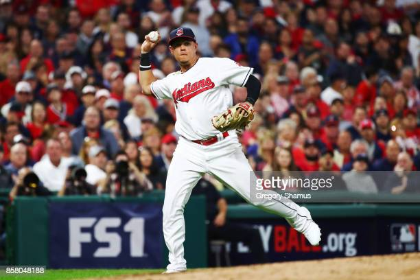 Giovanny Urshela of the Cleveland Indians throws out the runner during the second inning against the New York Yankees during game one of the American...