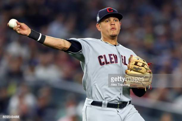 Giovanny Urshela of the Cleveland Indians throws to first base for the out during Game 4 of the American League Division Series against the New York...