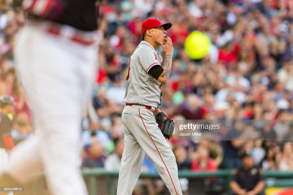 Giovanny Urshela #39 of the Cleveland Indians walks to first as starting pitcher Jesse Chavez #40 of the Los Angeles Angels of Anaheim reacts during the second inning at Progressive Field on July 25, 2017 in Cleveland, Ohio.