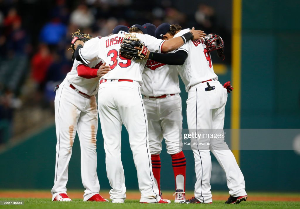 Giovanny Urshela #39 Yandy Diaz #36 Francisco Lindor #12 and Erik Gonzalez #9 of the Cleveland Indians celebrate a 10 -1 victory over the Chicago White Sox during the ninth inning at Progressive Field on September 29, 2017 in Cleveland, Ohio.