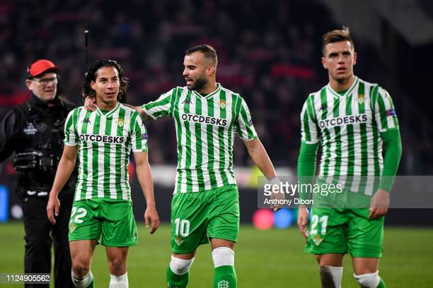 Giovano Lo Celso Diego Lainez and Jese of Real Betis celebrate with fans during the UEFA Europa League Round of 32 First Leg match between Rennes and...