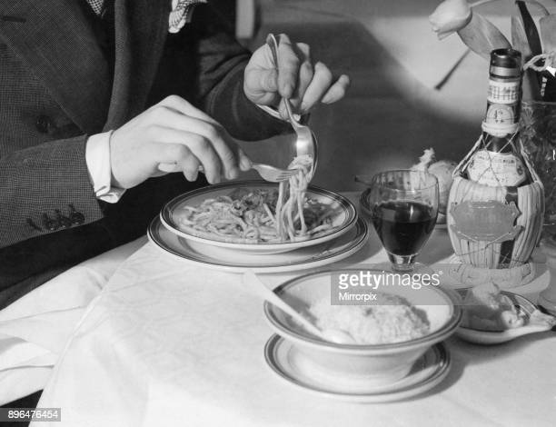Gioyanni Purio of Soho, London, an ex-bootlegger from America, demonstrates the correct way to eat spaghetti. Furio told the Daily Mirror that he got...