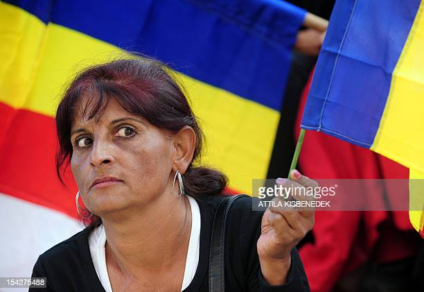 A gipsy woman holds her gipsyflag as sympathizers and members of the gipsy minority listen to a speech in downtown of the second bigest Hungarian...